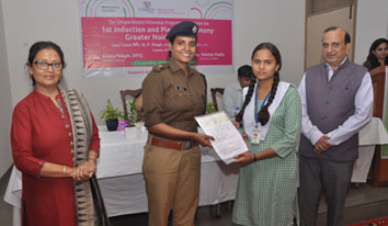 Girl receiving cheque at Greater Noida